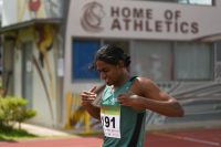 Kiranraj s/o Suresh beating his chest in celebration after he crosses the line during the Men's 1500 Metre Run Open race. (Photo 1 © Stefanus Ian/Red Sports)