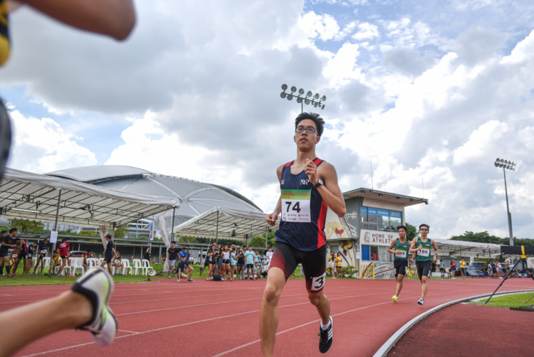 Kass Kwok of Nanyang Polytechnic going into the bend during the the Men's 1500 Metre Run Open race. (Photo 1 © Stefanus Ian/Red Sports)