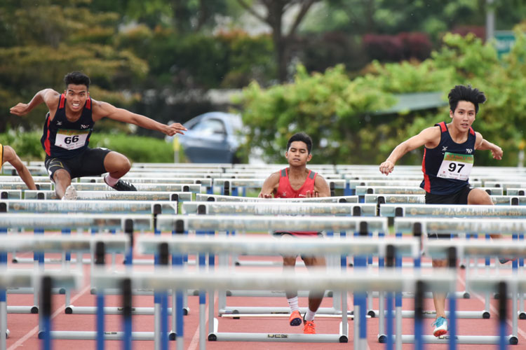 (Left to right) Hairul Syamil Bin Mardan of NYP, Hafiz bin Misnal of TP and Isaac Toh of NYP racing together in the centre lanes during the 2018 POL-ITE 110m hurdles race. Hafiz had to pull out of the race after failing to clear the fifth hurdle. (Photo 1 © Stefanus Ian/Red Sports)