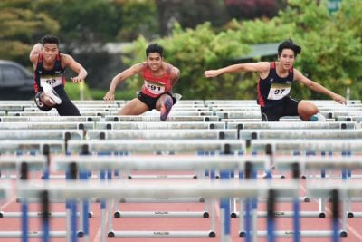 (Left to right) Hairul Syamil Bin Mardan of NYP, Hafiz bin Misnal of TP and Isaac Toh of NYP racing together in the centre lanes during the 2018 POL-ITE 110m hurdles race. (Photo 1 © Stefanus Ian/Red Sports)