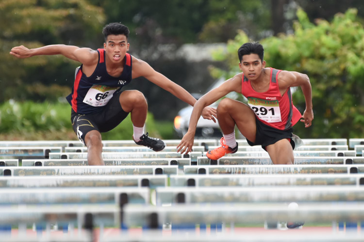 (Left to right) Hairul Syamil Bin Mardan of NYP and Hafiz bin Misnal of TP racing together in the centre lanes during the 2018 POL-ITE 110m hurdles race. (Photo 1 © Stefanus Ian/Red Sports)