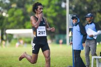 Nabin Parajuli blowing a kiss as he crossed the finish line first in the 5000m race. (Photo 1 © Stefanus Ian/Red Sports)
