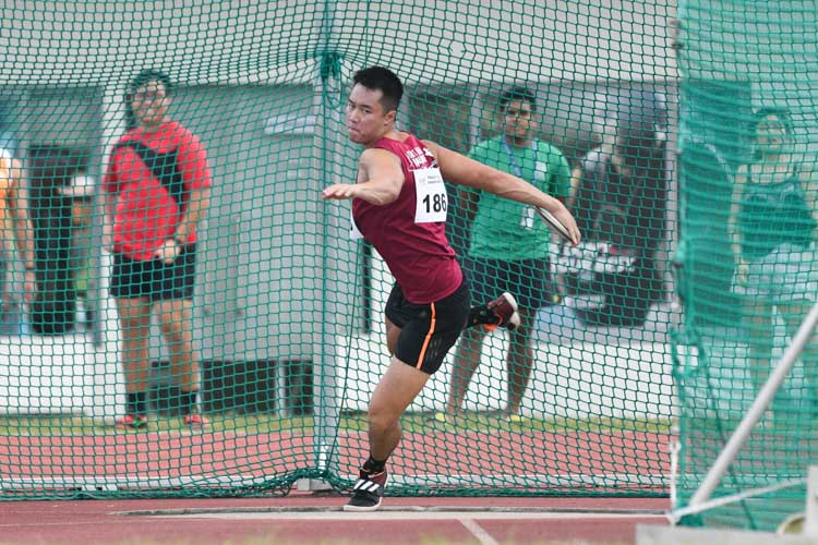 Brian See of NUS winds up to throw the discus. (Photo 8 © Stefanus Ian/Red Sports)