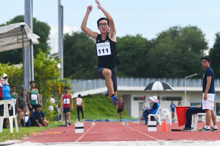 Justin Lee (#111) of NTU finished fourth in the Men's Triple Jump event with a distance of 13.68m. (Photo 1 © Stefanus Ian/Red Sports)
