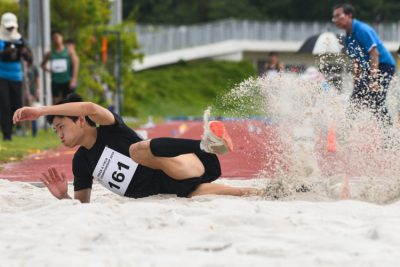 Chan Zhe Ying (#161) of NUS won the Men's Triple Jump event with a distance of 14.40m. (Photo 1 © Stefanus Ian/Red Sports)