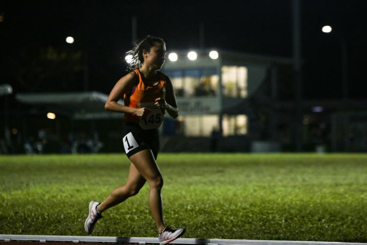 Lok Xin Ying of NUS during the women's 10,000m. (Photo 1 © REDintern Young Tan)