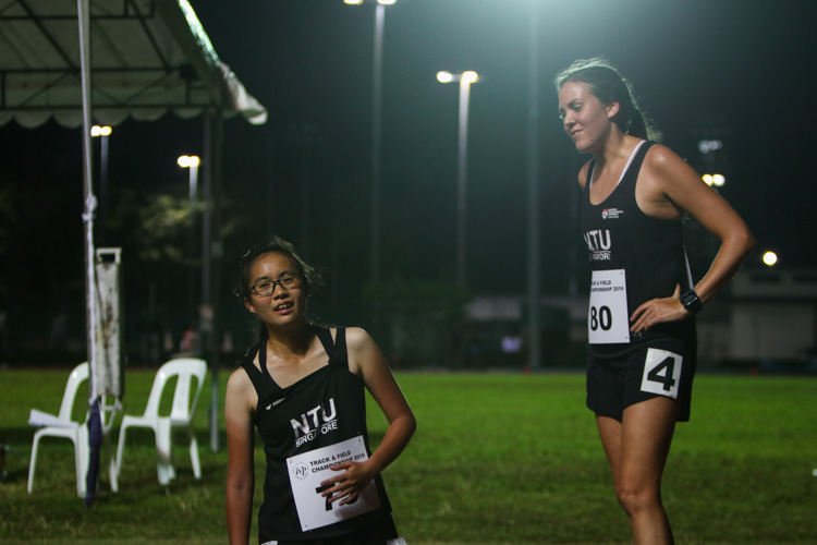 Eunice Choy (left) and Joanna McFarland of NTU catching their breath after the women's 10,000m. They finished third and second respectively. (Photo 1 © REDintern Young Tan)