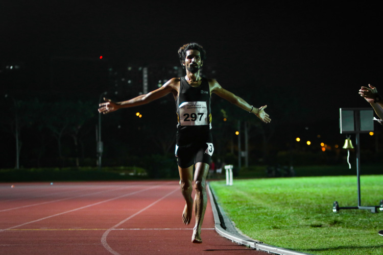 Nabin Parajuli (#297) of SIM celebrates at the end of the men's 10,000m. It is his second gold at this year's IVP Championships after his win in the 5000m. (Photo 1 © REDintern Young Tan)