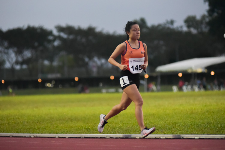 Lok Xin Ying (#145) of NUS comfortably won the women's 10,000m event with a timing of 43:32.90. (Photo 1 © Iman Hashim/Red Sports)