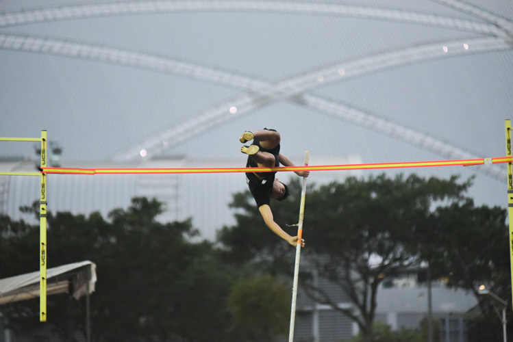 Joel Ho (#452) of Ngee Ann Polytechnic during a practice jump. He eventually won the IVP men's pole vault event with a height of 4.40m, beating NTU's Dewey Ng on countback. (Photo 1 © Iman Hashim/Red Sports)