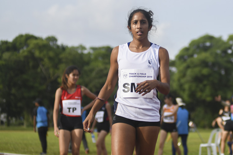 Shanti Pereira of SMU catches her breath after catching her competitors in the second leg of the 4x400m relay. (Photo 6 © Stefanus Ian/Red Sports)