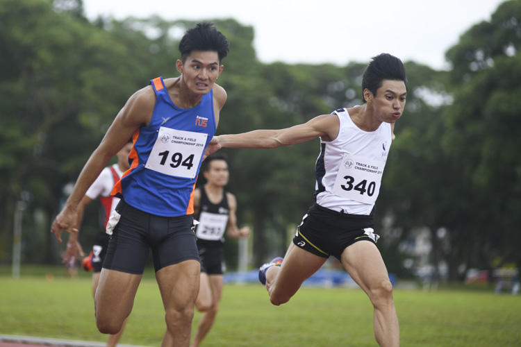 Timothee Yap of NUS (#194) and Tan Zong Yang of SMU (#340) dipping into the finish line. Timothee Yap of NUS won the Men's 200m race by 0.04s, stopping the clock at 21.65s as Tan Zong Yang of SMU came in second at 21.69s. (Photo 1 © Stefanus Ian/Red Sports)