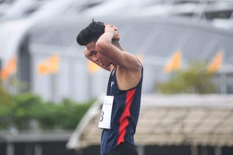 Hairul Syamil reacting after failing to clear the 2.05m height that would have broken the 10-year-old IVP record of 2.04m set by his current coach Ronnie Cai in 2009. Hairul still won the IVP gold medal for Men's High Jump with a final height of 2.00m (Photo 1 © Stefanus Ian/Red Sports)