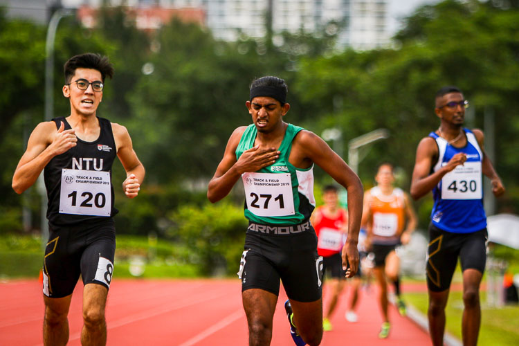 Kiran Raj s/o Suresh beating his chest after coming in first in his timed Men's 800m race. He would clinch silver with a time of 2:03.32 (Photo 1 © REDintern Young Tan)