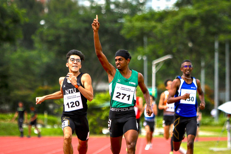 Kiran Raj s/o Suresh celebrating his chest after coming in first in his timed Men's 800m race. He would clinch silver with a time of 2:03.32 (Photo 1 © REDintern Young Tan)