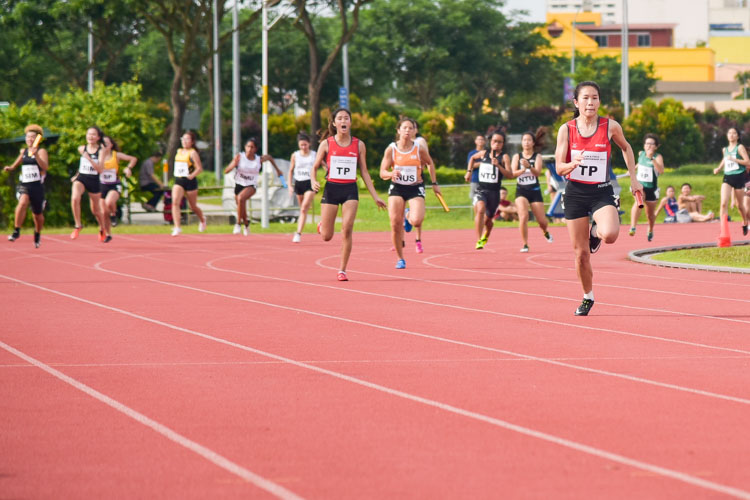 Andreana Tang anchoring Temasek Polytechnic in the Women's 4x100m relay final. Along with Alanis Moey, Haanee Hamkah and Clara Goh, TP clinched the gold with a time of 50.76s. (Photo 1 © Iman Hashim/Red Sports)