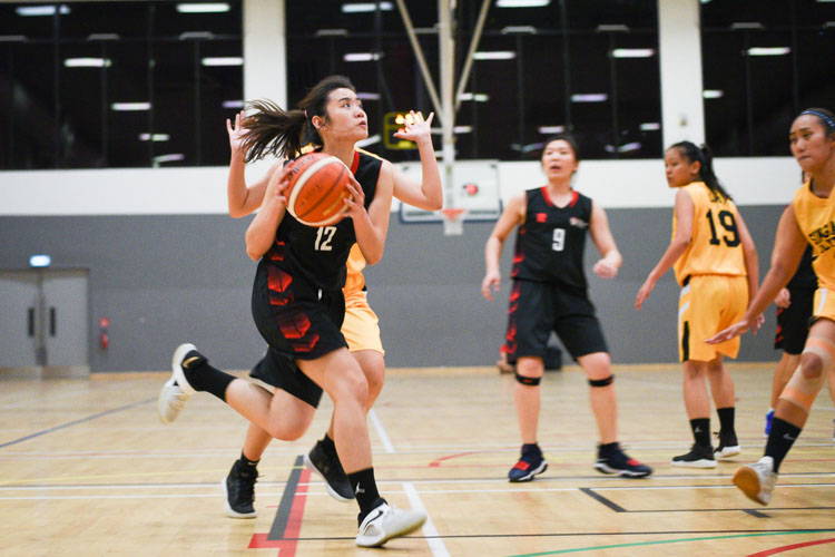 Woon Wei Jing (NTU #12) goes for the lay-up. NTU beat SP 63-44 to advance to the IVP Basketball Championship final. (Photo 5 © Iman Hashim/Red Sports)
