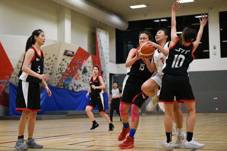 Joanne Lim (#TP 2) attempts to drive in but is blocked by SIT players. SIT edged out TP 55-53 to move on to the IVP Basketball Championship final. (Photo 10 © Iman Hashim/Red Sports)
