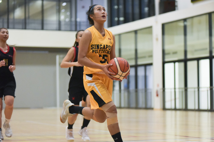 Tiana Ng (SP #35) eyes the lay-up. SP beat TP 60-50 to clinch third place in the IVP Women's Basketball Championship. (Photo 6 © Iman Hashim/Red Sports)