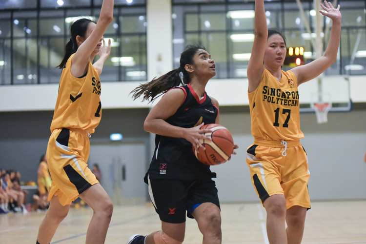 Navanee D/O Amurthalingam (TP #4) in action. SP beat TP 60-50 to clinch third place in the IVP Women's Basketball Championship. (Photo 7 © Iman Hashim/Red Sports)