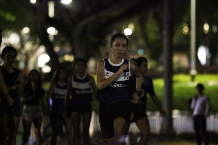 Charis Chan running the anchor leg for Kent Ridge Hall in the women's race. Her split of 7:51 was enough for KR to clinch second place, after teammate Vanessa Lee had run an unofficial course record of 6:30 on the fourth leg to go from 4th to 2nd. (Photo 6 © REDintern Young Tan)