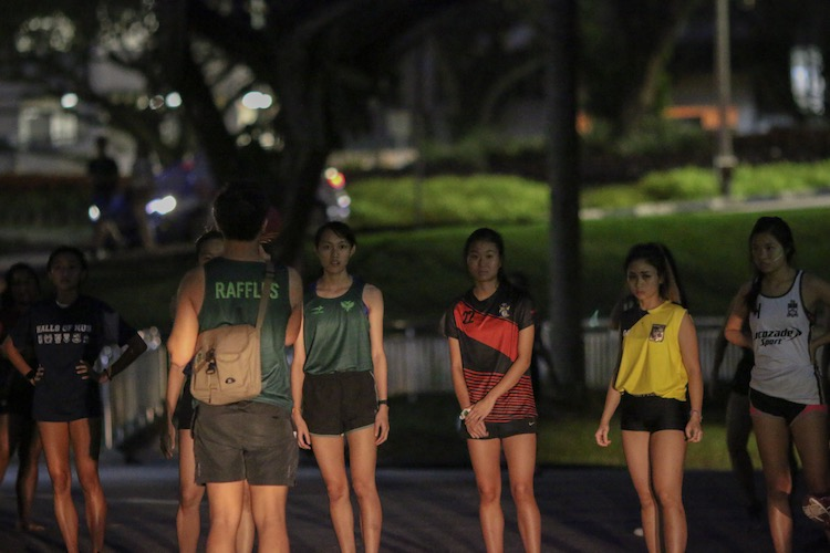 Runners listening to a briefing before the flag-off for the women's race. (Photo 7 © REDintern Young Tan)