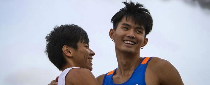 Timothee Yap of NUS and Tan Zong Yang of SMU hug after a close fought dash between 1st and 2nd place.