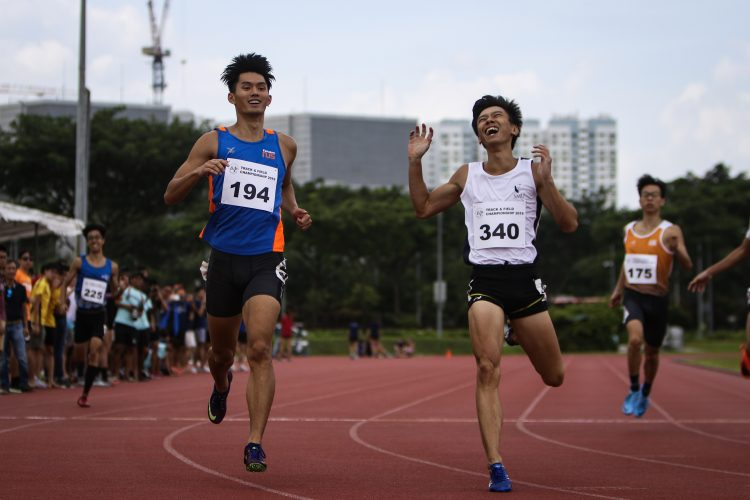 Timothee Yap of NUS and Tan Zong Yang of SMU smile and chuckle after their neck and neck performance.