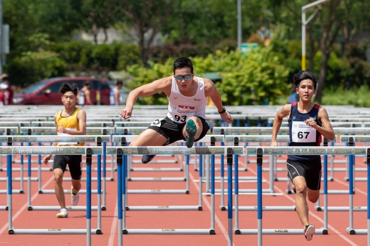 Elston Lim of SP, Ding Hui of NT, and Isaac Toh of NYP competing during the IVP 110m Men's Hurdles heats  Ding Hui (center) finished in 3rd place over both heats. (Photo 16 © Jared Khoo/REDintern)