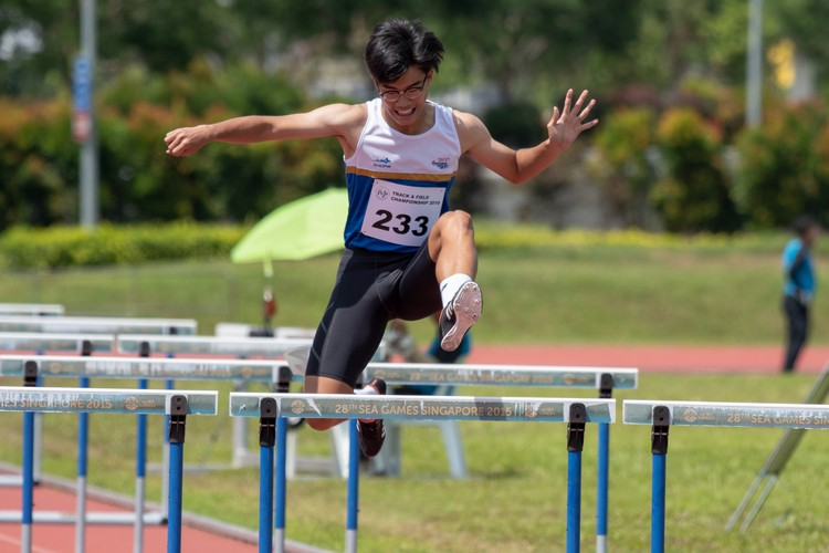 Lim Wei Jie of Ngee Ann Polytechnic leaps over a hurdle in the 110-meter men's open prelims.