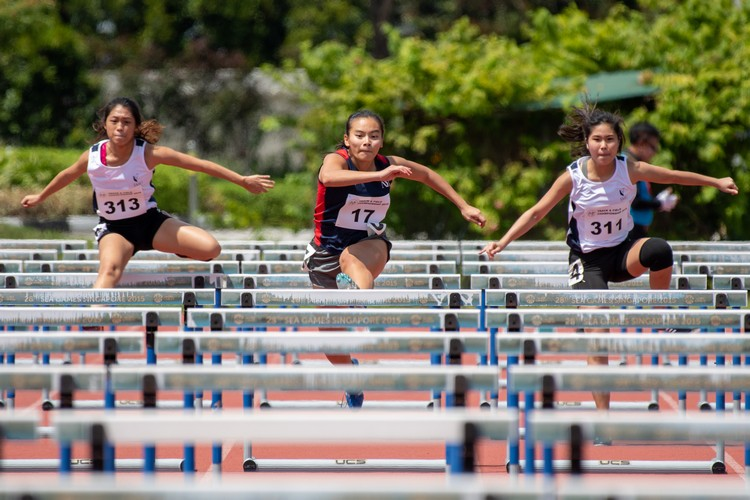 Tessa Goh of SMU, Hannah Esther Tan of NP, and Britney Chia of SMU. Hannah (center) finished 2nd in the 100-meter women's hurdles open.
