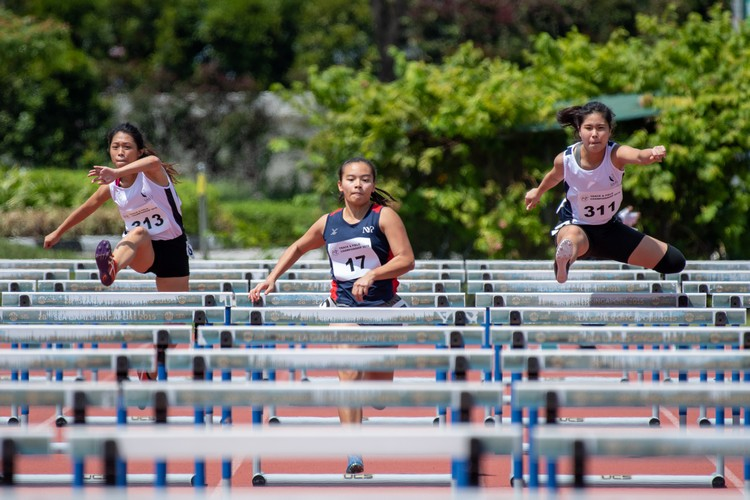 (Left to right) Tessa Goh of SMU, Hannah Esther Tan of NYP, and Britney Chia of SMU. Hannah (center) finished 2nd in the 100-metre hurdles women's final. (Photo 10 © Jared Khoo/REDintern)