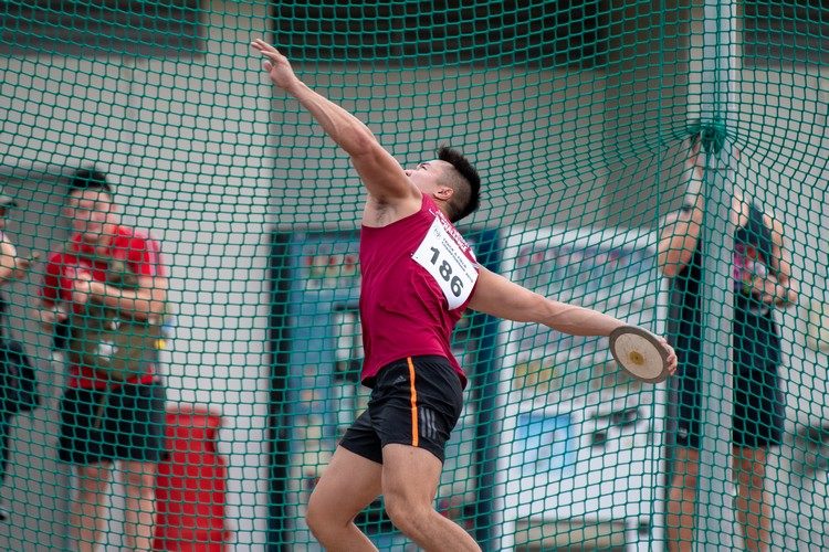 Brian See of NUS winds up to throw the discus. (Photo 8 © Jared Khoo/REDintern)