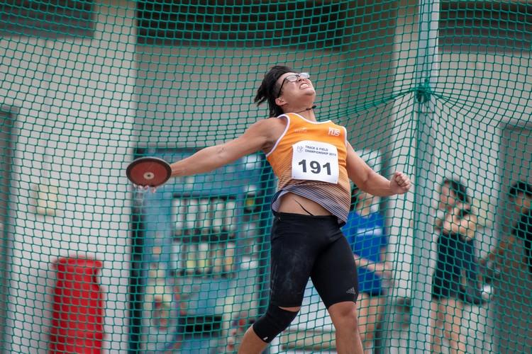 Tan Ting Jun of NUS won 2nd place in the men's discus throw open. (Photo 11 © Jared Khoo/REDintern)