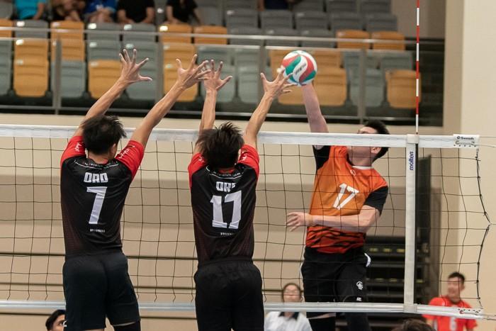 Kieth Ang Chun Lai (#17) of Spaiko takes a shot against ORD players Benjamin Choo (#7) and Travis Ang (#17).