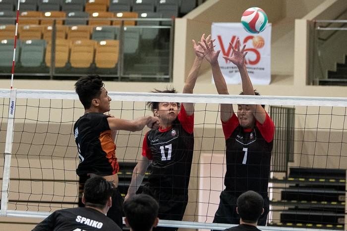 Ranjit A/L Ramu (#6) of Spaiko taking a shot over the net against Travis Ang (#17) and Benjamin Choo (#7) of ORD.
