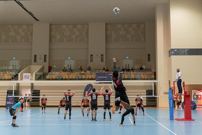 Ajay Shergill (#9) of ORD sends an overhead serve to Team Spaiko.(Photo 16 © REDintern Jared Khoo)