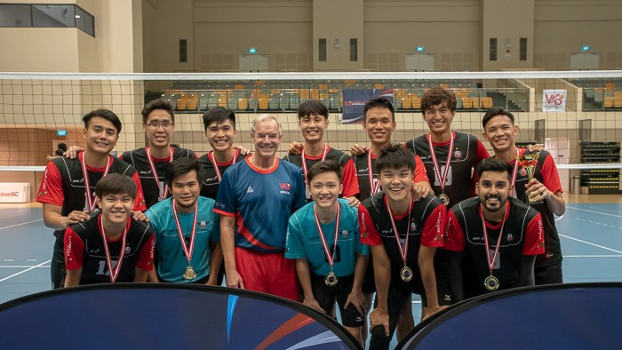 Team ORD poses with official Mr. Dennis Jensen for a picture after receiving their first-place medals.