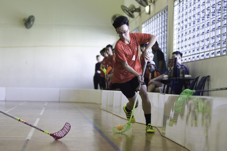 Almanzo Chee (SGS #4) tries to get past his defender. St. Gabriel's Secondary beat St. Patrick's Secondary 17-1 to improve to a 2-1 win-loss record in the National B Division Floorball Championship. (Photo 1 © Iman Hashim/Red Sports)