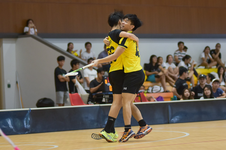 Eusoffians embrace after their third goal of the match. (Photo 4 © Iman Hashim/Red Sports)