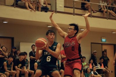 Captain Tay Wee (Hall 12 #6) caught in action attempting to shoot.