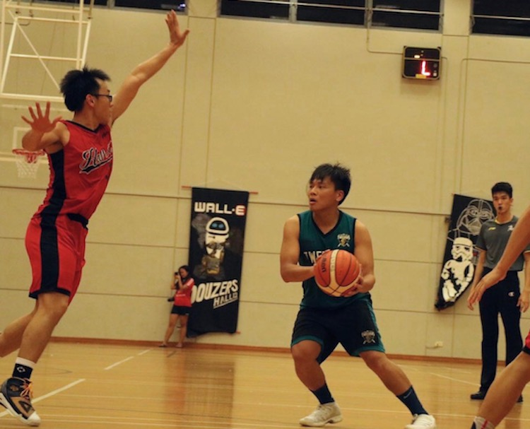 Chua Cheng Wei (#9) of Hall 12 attempting to get through defender to make a pass to fellow teammate