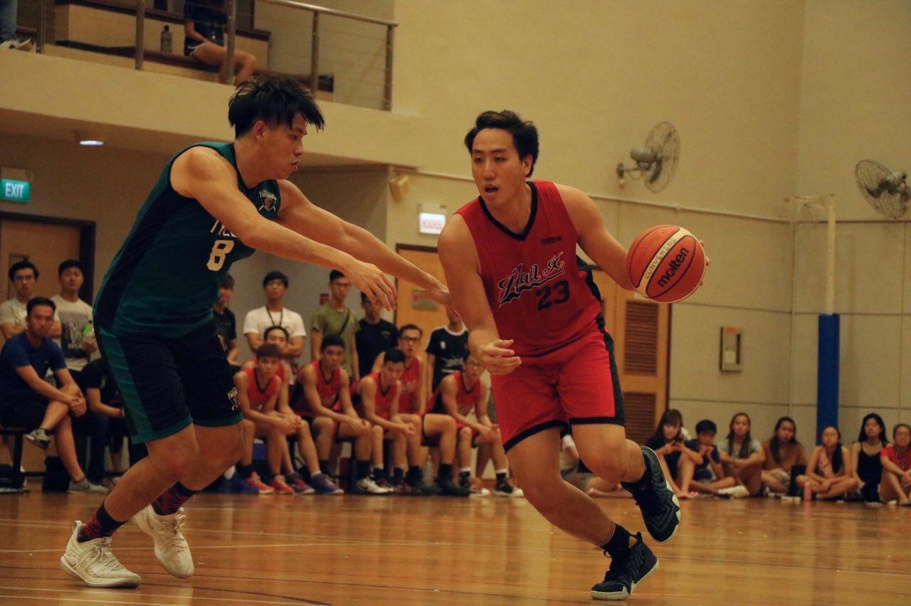 Alvin Chun Wang Xuan (#23) of Hall 10 dribbling past defender swiftly to make a successful shot.