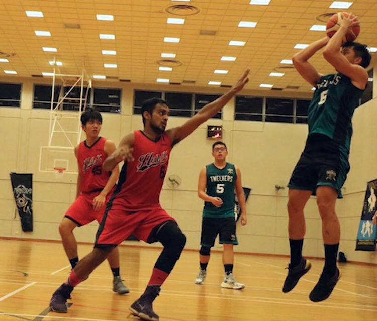 Hashen Singh Dhillion (#6) of Hall 10 going forth to defend opponent's shot for the hoop.