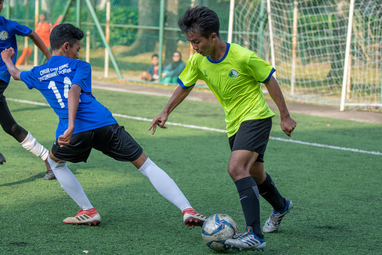 Winger Mhd Arshad (#16) sets up a cross. Mhd Aidil (#14) reaches back to stop him.