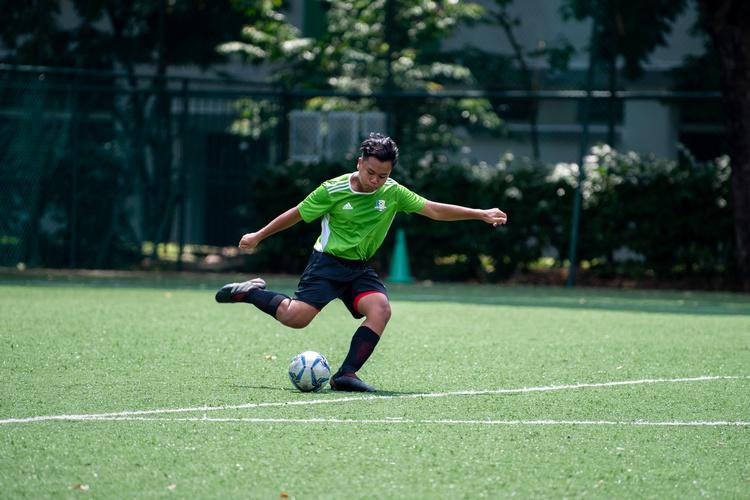 Shabirin (#5) of OPSS kicking the ball during the match. (Photo 2 © Jared Khoo/REDintern)