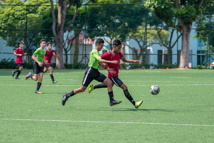 Elfiyan Abdullah Bakar (#13) of SGS and Haidil (#4) of OPSS fight for the ball. (Photo 5 © Jared Khoo/REDintern)