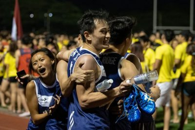 The Kent Ridge Hall team celebrates after the mixed medley. Their win in that event helped them pip Eusoff Hall by one point to clinch the Men's IHG Track title for the third straight year. (Photo 1 © REDintern Jared Khoo)