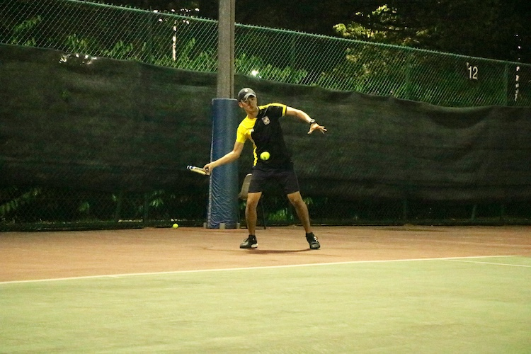 Wilbert Loh of Eusoff Hall in action against Temasek Hall during the Men's Singles match of the NUS IHG. (Photo 2 by REDIntern Julianna Jothi)