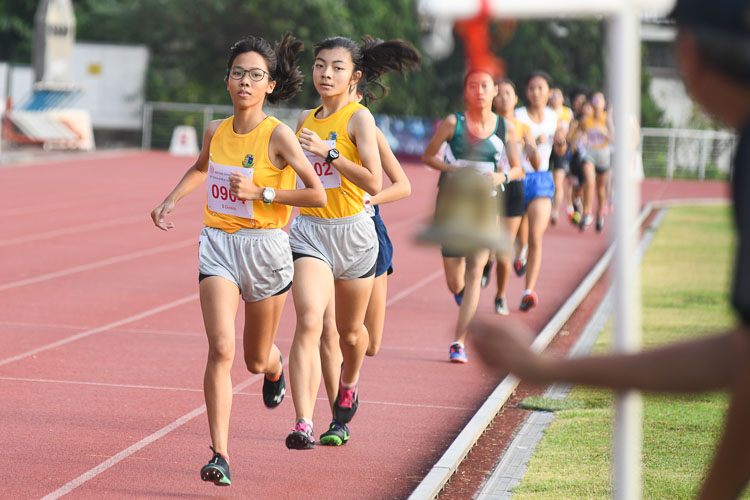 Claudia Tang and Kylie Tan of Cedar Girls' Secondary School leading the pack as they enter the last lap of the B division girls 1500m final (Photo 1 © Stefanus Ian/Red Sports)